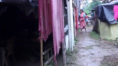 Tracking shot through flood relief camp in India to distribution of food Stock Footage