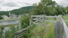 Panoramic vue of a river and town in foreground Stock Footage