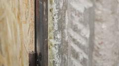 Polyurethane foam fills in gap. - stock footage