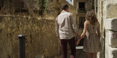 Stock Video Footage of Romantic couple walking in alley on a sunny day