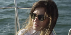 Stock Video Footage of Woman relaxing on sailboat