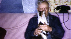 SAD Old Man Holds Pets Cat Lonely 1950s Vintage Film Home Movie 9314 Stock Footage