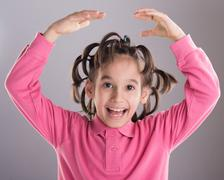 Portrait of funny cute little boy with awesome hairdo Stock Photos