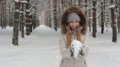 Young woman play with snow, in the winter forest Stock Footage