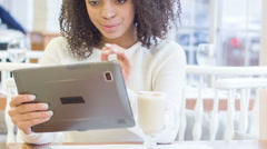 Young woman using digital tablet Stock Footage