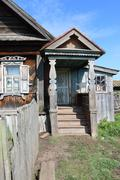 Front porch of a very old wooden house in the remote Russian village in the s - stock photo