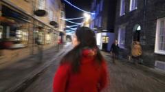 Fast Forward Girl Walking through Festive City Stock Footage