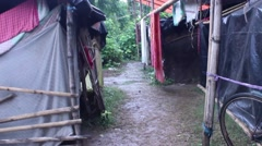 Tracking shot through relief camp in India Stock Footage