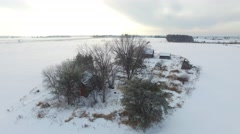4k aerial of decrepid isolated buildings in snowy field Stock Footage