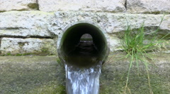 Canalization - Water flowing inside old pipe - zoom in  Stock Footage