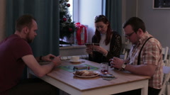Woman and men playing a board game with cards Stock Footage