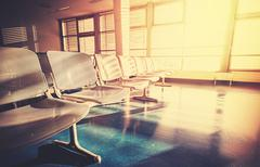 Vintage filtered picture of empty airport waiting room at sunrise - stock photo