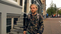 Hipster tourist is walking along European streets Stock Footage