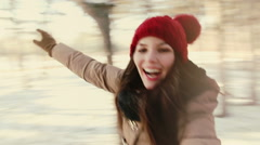 Girl whirls, laughing at the camera. Winter, Snow, Forest Park Stock Footage