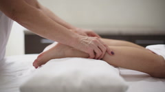 Female hands doing foot massage Stock Footage