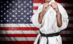 Karate fighter and american flag Stock Photos