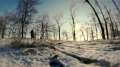 Sledging. A man with a woman move out of the snow-covered hills Stock Footage