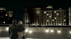 Romantic Couple in Love Looking at View of building at night. Back view. Stock Footage