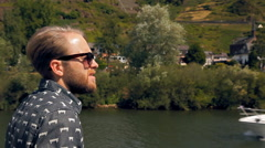 Hipster tourist is sailing on a ship Stock Footage