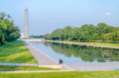 Defocused background of G. Washington Monument and Reflecting Pool, Washingto - stock photo