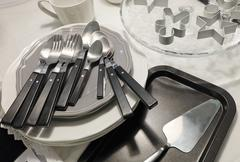 Kitchen Utensil, Ceramic Plates, Coffee Cup, Silverware, Cake Spatula and Coo - stock photo