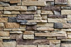 Background Pattern, Horizontal Brown Asymmetrical Brick Wall Background or Te - stock photo