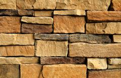 Background Pattern, The Horizontal Brown Asymmetrical Stone Wall Background o - stock photo