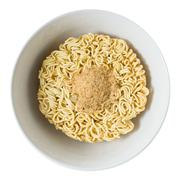 Cuisine and Food, Asian Ramen Dried Instant Noodles Blocks with Flavoring Pow - stock photo