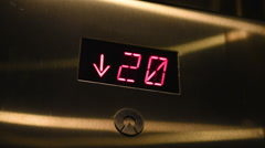 Close up of elevator numbers descending Stock Footage