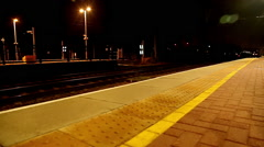 Fast train overground london night on platform Stock Footage
