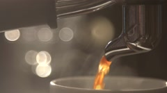 Coffee flows from cofee machine in slow motion Stock Footage