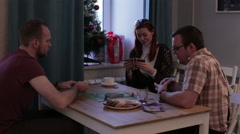 Group of people playing a board game with cards Stock Footage