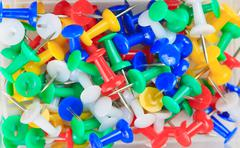 background of multicolored thumbtacks - stock photo
