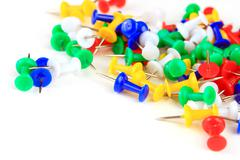 colorful thumbtacks on a white background - stock photo