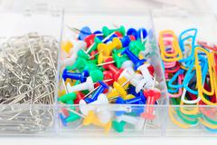 multicolored paper clips and buttons stationery - stock photo