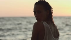 Sexy woman at sunset in the sea Stock Footage