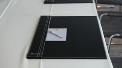 Desk pad and pen on empty conference table Stock Footage