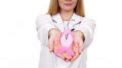 Woman doctor showing pink ribbon aids symbol 4K - stock footage