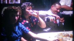 3122 family party, drinking & eating at kitchen table -vintage film home movie Stock Footage