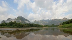 TIMELAPSE Karst mountains reflected and clouds,Vang Vieng,Laos Stock Footage