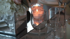 Close up of candle in centerpiece on set table Stock Footage
