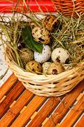 Stock Photo of Quail eggs in basket. Dietary.