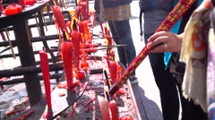 Thurification,slow motion of joss sticks,in leshan moutain - stock footage