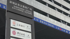 Chinese banks, Shenzhen stock exchange square, financial ticker board Stock Footage