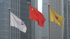 Flags at the Shenzhen stock exchange in China Stock Footage