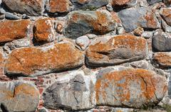 Old wall of large rusty boulders Stock Photos