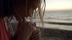 Thoughtful girl with wet hair near the ocean Stock Footage