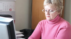 Woman answers the phone at the office Stock Footage