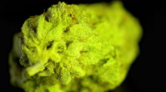 Rotating macro product shot of high quality marijuana, solid black background Stock Footage