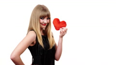 Stock Video Footage of Woman gorgeous girl holding red heart love symbol 4K